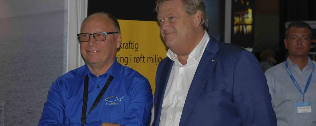 BlueFish-sjef Geir Østensen, sammen med fiskeri- og sjømatminister Harald Tom Nesvik under årets BlueFish i Ålesund. Foto: Kurt W. Vadset